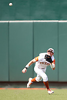 Texas Longhorns outfielder Tim Maitland #9 makes a catch during the NCAA baseball game against the Texas A&M Aggies on April 28, 2012 at UFCU Disch-Falk Field in Austin, Texas. The Aggies beat the Longhorns 12-4. (Andrew Woolley / Four Seam Images).