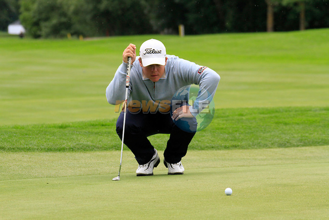 George Coetzee (RSA) lines up his putt on the 18th green during of Day 3 of the BMW International Open at Golf Club Munchen Eichenried, Germany, 25th June 2011 (Photo Eoin Clarke/www.golffile.ie)