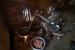 A woman cooks food in her shelter in the Doro Refugee Camp in Maban County, South Sudan. Doro is one of four camps in Maban that together shelter more than 130,000 refugees from the Blue Nile region of Sudan. Jesuit Refugee Service provides educational and psycho-social services to both refugees and the host community. <br /> <br /> Misean Cara supports the work of JRS in the Maban camps.