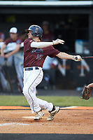Sam Walker (12) of Kannapolis Post 115 follows through on his swing against Mooresville Post 66 during an American Legion baseball game at Northwest Cabarrus High School on May 30, 2019 in Concord, North Carolina. Mooresville Post 66 defeated Kannapolis Post 115 4-3. (Brian Westerholt/Four Seam Images)