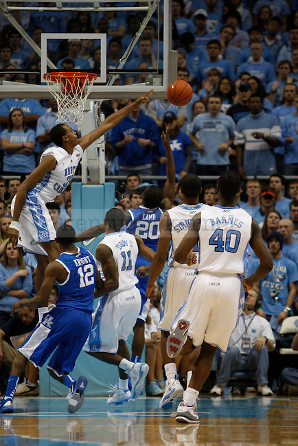 A shot by Doron Lamb gets blocked by a North Carolina player on Dec. 4, 2010.  Photo by Latara Appleby | Staff