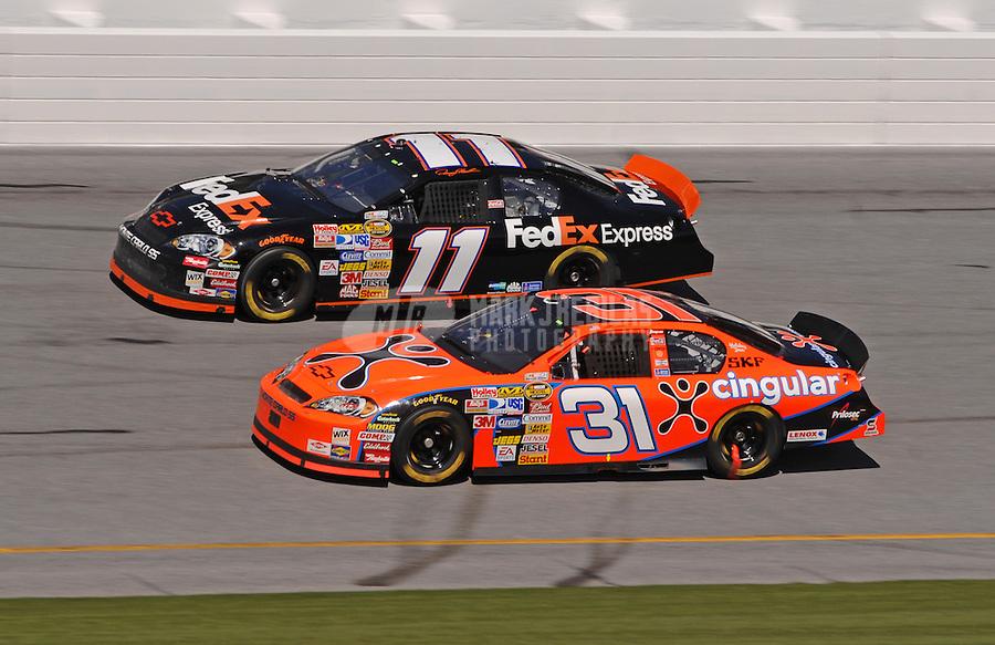 Feb 17, 2007; Daytona, FL, USA; Nascar Nextel Cup Series driver Jeff Burton (31) races alongside Denny Hamlin (11) during practice for the Daytona 500 at Daytona International Speedway. Mandatory Credit: Mark J. Rebilas