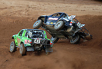 Apr 17, 2010; Surprise, AZ USA; LOORRS super lite driver Colton Greaves flips over alongside Chad George (42) on the last lap during round 3 at Speedworld Off Road Park. Mandatory Credit: Mark J. Rebilas-US PRESSWIRE.