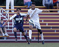Boston College forward Charlie Rugg (17) dribbles as University of Rhode Island (URI) defender Jon Cloutier (2) defends. Boston College defeated University of Rhode Island, 4-2, at Newton Campus Field, September 25, 2012.