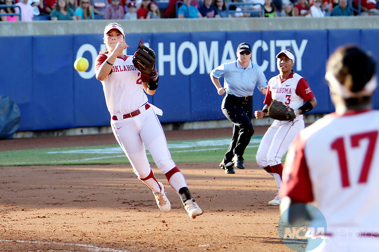 06 JUNE 2016: Sydney Romero (2) of University of Oklahoma throws the ball to first base against Auburn University during the Division I Women's Softball Championship held at ASA Hall of Fame Stadium in Oklahoma City, OK.  University of Oklahoma defeated Auburn University in Game 1 by the final score of 3-2. Shane Bevel/NCAA Photos