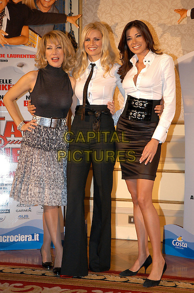 NANCY BRILLI, MICHELLE HUNZIKER & AIDA YESPICA.Photocall for the film di Neri Parenti 'Natale in crociera'.December 13th, 2007.full length black top grey gray silver skirt pattern white shirt hand on hip tie high waist waisted trousers belt.CAP/CAV.©Luca Cavallari/Capital Pictures.