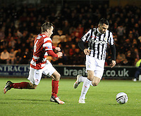 Steven Thompson breaking from Jon Routledge in the St Mirren v Hamilton Academical Scottish Communities League Cup match played at St Mirren Park, Paisley on 25.9.12.