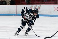 BOSTON, MA - FEBRUARY 16: Nicole Dunbar #4 of University of New Hampshire brings the puck forward during a game between University of New Hampshire and Boston University at Walter Brown Arena on February 16, 2020 in Boston, Massachusetts.