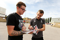 Lincoln City's Harry Toffolo signs autographs for waiting fans as he arrives ahead of kick-off at SIncil Bank<br /> <br /> Photographer Rich Linley/CameraSport<br /> <br /> The EFL Sky Bet League One - Lincoln City v Bristol Rovers - Saturday September 14th 2019 - Sincil Bank - Lincoln<br /> <br /> World Copyright © 2019 CameraSport. All rights reserved. 43 Linden Ave. Countesthorpe. Leicester. England. LE8 5PG - Tel: +44 (0) 116 277 4147 - admin@camerasport.com - www.camerasport.com