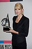 "TAYLOR SWIFT WITH AWARD.American Music Awards 2010,Nokia Rheatre, Los Angeles_21/10/2010.Mandatory Photo Credit: ©Dias/Newspix International..**ALL FEES PAYABLE TO: ""NEWSPIX INTERNATIONAL""**..PHOTO CREDIT MANDATORY!!: NEWSPIX INTERNATIONAL(Failure to credit will incur a surcharge of 100% of reproduction fees)..IMMEDIATE CONFIRMATION OF USAGE REQUIRED:.Newspix International, 31 Chinnery Hill, Bishop's Stortford, ENGLAND CM23 3PS.Tel:+441279 324672  ; Fax: +441279656877.Mobile:  0777568 1153.e-mail: info@newspixinternational.co.uk"