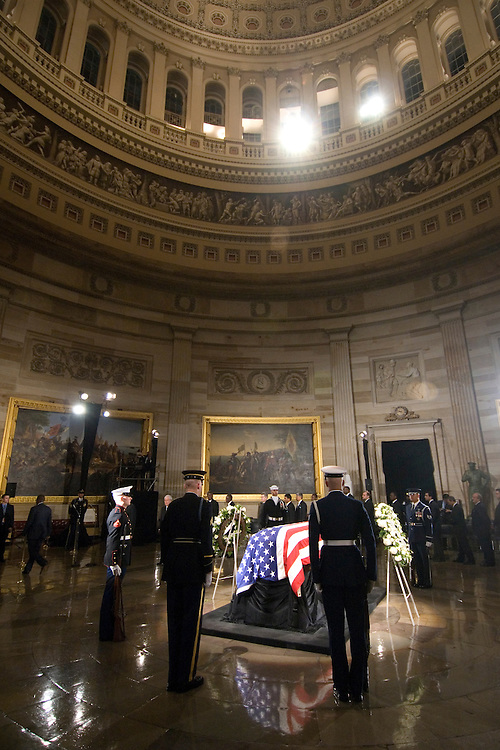 The military honor guard stands guard over former President Gerald Ford's coffin after the state funeral for Ford in the Rotunda of the U.S. Capitol in Washington on Saturday evening, Dec. 30, 2006.