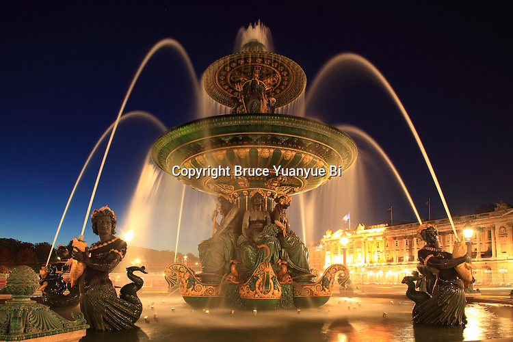 The night view of Fountain of River Commerce and Navigation in Place de la Concorde. Paris. France
