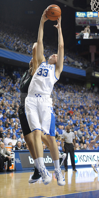 Kyle Wiltjer (33) grabs a rebound during the first half of the University of Kentucky Basketball game against Loyola at Rupp Arena in Lexington, Ky., on 12/22/11. UK led at half 45-39. Photo by Mike Weaver | Staff