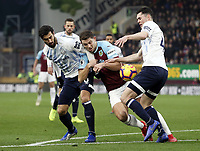 Burnley's James Tarkowski battles with Everton's Andre Gomes (left) and Michael Keane<br /> <br /> Photographer Rich Linley/CameraSport<br /> <br /> The Premier League - Burnley v Everton - Wednesday 26th December 2018 - Turf Moor - Burnley<br /> <br /> World Copyright &copy; 2018 CameraSport. All rights reserved. 43 Linden Ave. Countesthorpe. Leicester. England. LE8 5PG - Tel: +44 (0) 116 277 4147 - admin@camerasport.com - www.camerasport.com