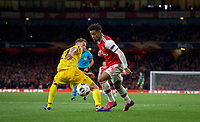 Reiss Nelson of Arsenal goes past Mergim Vojvoda of Standard Liege during the UEFA Europa League match between Arsenal and Standard Liege at the Emirates Stadium, London, England on 3 October 2019. Photo by Andrew Aleks.