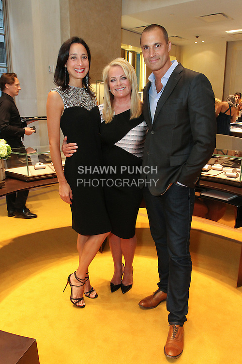 Fashion designer Pamella Roland (center) poses with photographer Nigel Barker and his wife Cristen Barker, during Pamella Roland Resort 2017 collection fashion presentation at Bvlgari located at 4 West 57 Street in New York City, on June 8, 2018.