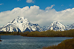 The Grand Teton Mountains covered in snow with a blue ski and clouds seen from Oxbow Bend in Grand Teton National Park, June 2, 2011.  Photo by Gus Curtis