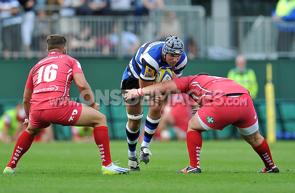 Charlie Ewels takes on the Scarlets defence. Pre-season friendly match, between Bath Rugby and the Scarlets on August 16, 2014 at the Recreation Ground in Bath, England. Photo by: Patrick Khachfe / Onside Images