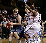 SIOUX FALLS, SD: MARCH 22: Adam Laine #42 from Colorado Mines looks past a double team including Adam Eberhard #22 from Bellarmine during the Men's Division II Basketball Championship Tournament on March 22, 2017 at the Sanford Pentagon in Sioux Falls, SD. (Photo by Dave Eggen/Inertia)
