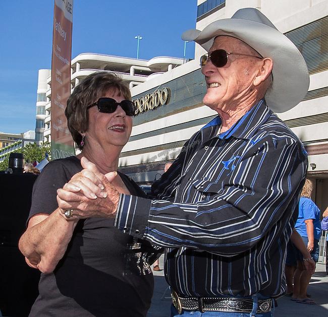 Joann Fehrmann and Deno Capley dance during the 35th Annual Eldorado Great Italian Festival held in downtown Reno on Saturday, October 8, 2016.