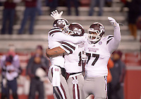 NWA Democrat-Gazette/BEN GOFF @NWABENGOFF<br /> Joe Morrow (from left), Mississippi State wide receiver, Dak Prescott, quarterback, and Rufus Warren, left tackle, celebrate as the clock winds down on their 51-50 win over Arkansas, on Saturday Nov. 21, 2015 during the game in Razorback Stadium in Fayetteville.