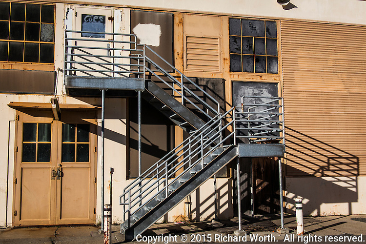 A metal staircase creates lines and angles on a vacant building at the former Naval Air Station Alameda.