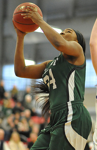 Kem Nwabudu #24 of Elmont shoots from short range during the Class A Long Island Championship against Hauppauge at Suffolk County Community College Grant Campus in Brentwood on Thursday, March 8, 2018. Elmont won by a score of 56-30.