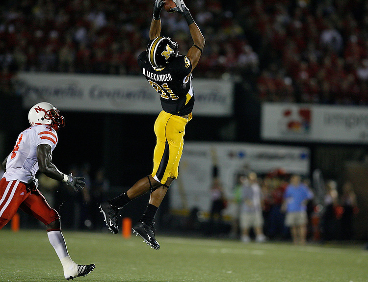 MU wide receiver Danario Alexander catches a pass with Nebraska Cornhuskers safety Larry Asante covering and takes it in for a 48 yard touchdown during the third quarter at Memorial Stadium in Columbia, Missouri on October 6, 2007. The Tigers won 41-6.