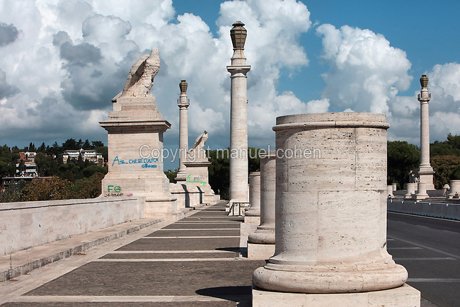 The Ponte Flaminio, built 1938-51, designed by Armando Brasini, 1879-1965, in Fascist style, with columns and monumental sculptures of eagles, Corso di Francia, Rome, Italy. Fascist architecture developed in the late 1920s and 1930s, as a modernist style in times of nationalism and totalitarianism under Benito Mussolini. It is characterised by large, square, symmetrical buildings with little or no decoration, often inspired by ancient Rome and designed to convey strength and power. Picture by Manuel Cohen