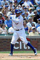 Chicago Cubs shortstop Starlin Castro #13 awaits a pitch during a game against the Arizona Diamondbacks at Wrigley Field on July 15, 2012 in Chicago, Illinois. The Cubs defeated the Diamondbacks 3-1. (Tony Farlow/Four Seam Images).