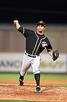 Omaha Storm Chasers pitcher Ramon Troncoso (24) delivers a warmup pitch during the second game of a double header against the Nashville Sounds on May 21, 2014 at Herschel Greer Stadium in Nashville, Tennessee.  Nashville defeated Omaha 13-4.  (Mike Janes/Four Seam Images)
