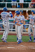 Team mates Ramon Rodriguez (6), Kevin Lachance (5), and Donovan Casey (43) of the Ogden Raptors meet Romer Cuadrado (17) after his hitting a grand slam against the Orem Owlz at Home of the Owlz on September 11, 2017 in Orem, Utah. Ogden defeated Orem 7-3 to win the South Division Championship. (Stephen Smith/Four Seam Images)