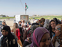Iraq 2013 .Day of shopping for refugees queuing up in front the supermarket near Domiz camp. Irak 2013.Des  refugies du camp de Domiz font la queue devant le supermarche a cote du camp