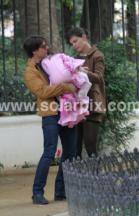**ALL ROUND PICTURES FROM SOLARPIX.COM**..**WORLDWIDE SYNDICATION RIGHTS - NO SYNDICATION IN SPAIN**..Tom Cruise took a break from filming new movie Night & Day in Seville to relax with Katie Holmes and daughter Suri. The family walked in a park in the centre of town and Suri showed off her new pink flamenco dress...JOB REF:   10348   OA1-EM       DATE:  06.12.09..**MUST CREDIT SOLARPIX.COM OR DOUBLE FEE WILL BE CHARGED**..**MUST NOTIFY SOLARPIX OF ONLINE USAGE**..**CALL US ON: +34 952 811 768 or LOW RATE FROM UK 0844 617 7637**