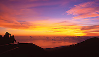 People enjoy the sunrise at Kalahaku Overlook in Haleakala National Park, Maui.