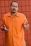 Mature hispanic man gesticulating and looking concerned