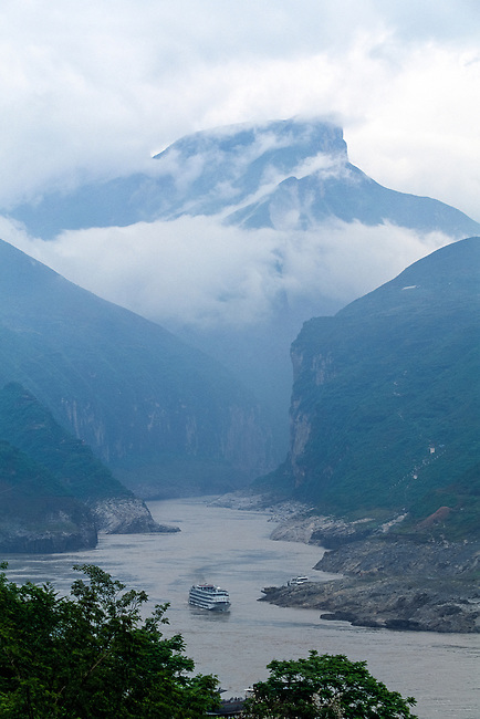boat of transport on the river in Qutang Gorge, Three Gorges of the Yangtze River, China