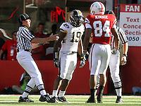 Referees step in to separate Nebraska wide receiver Brandon Kinnie (84) and Missouri defensive back Carl Gettis (19). No. 14 Nebraska beat No. 7 Missouri 31-17 at Memorial Stadium in Lincoln, Nebraska.