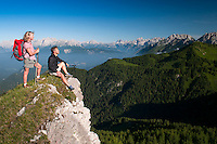 Forni di Sopra, Dolomiti Friulane, Italy, June 2011. Hikers at sunrise on the ridge above Varmost Ski area over Forni de Sopra. Dolomiti Friulane Regional Park is part of the western mountain area dominating the upper plain of Friuli. It lies between the rivers Tagliamento and Piave. The area is characterized by the wilderness of its large valleys which present nor main roads or villages and stretch among the Dolomitic peaks. Photo by Frits Meyst/Adventure4ever.com