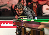 Ronni O'Sullivan watches his shot during his 6-3 win at the Dafabet Masters Quarter Final 3 match between Ronnie O'Sullivan and Mark Selby at Alexandra Palace, London, England on 14 January 2016. Photo by Liam Smith / PRiME Media Images