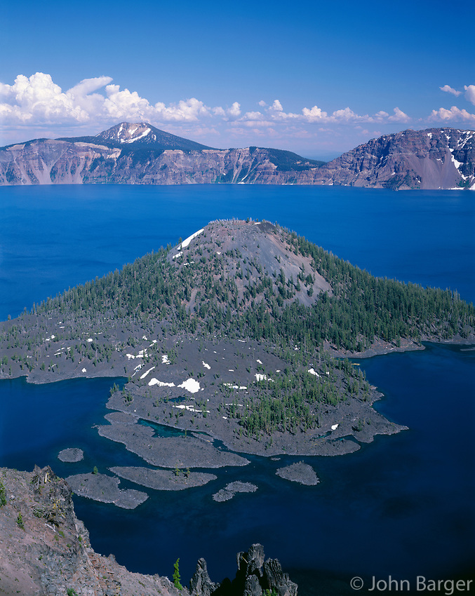 ORCL_056 - USA, Oregon, Crater Lake National Park, View east across Crater Lake from directly above Wizard Island with distant Mount Scott and thunder clouds.