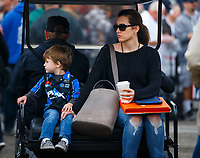 Feb 10, 2018; Pomona, CA, USA; Former NHRA funny car driver Ashley Force Hood with son XXXX during qualifying for the Winternationals at Auto Club Raceway at Pomona. Mandatory Credit: Mark J. Rebilas-USA TODAY Sports