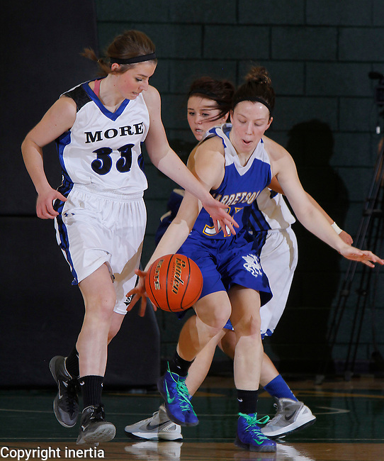 SPEARFISH, S.D. -- March 13, 2014 -- Hailey Edmundson #51 of Garretson and Ciara Duffy #33 of St. Thomas More battle for a loose ball during their opening round game at the 2014 South Dakota State A Girls Basketball Tournament at the Donald E. Young Center in Spearfish Thursday. (Photo by Dick Carlson/Inertia)