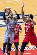 Washington, DC - Sept 17, 2017: Minnesota Lynx forward Maya Moore (23) goes up for a lay up against Washington Mystics guard Tierra Ruffin-Pratt (14) and Mystics center Krystal Thomas (34) during playoff game between the Mystics and Lynx at the Verizon Center in Washington, DC. (Photo by Phil Peters/Media Images International)