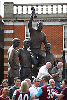 West Ham United fans gather around the Bobby Moore memorial  statue   during the Barclays Premier League match between West Ham United and Swansea City  played at Boleyn Ground , London on 7th May 2016