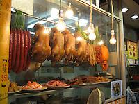Ducks hang in a shop window, Hong Kong