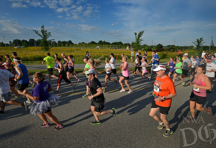 NWA Democrat-Gazette/BEN GOFF -- 06/13/15 Runners take off at the start on Saturday June 13, 2015 during The Cancer Challenge 10K, 5K Run & 1-Mile Walk at Memorial Park in Bentonville.
