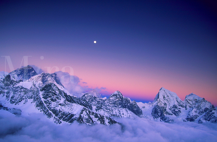 Sunset falling on the snow dusted face of Mount Everest, Nepal.<br />