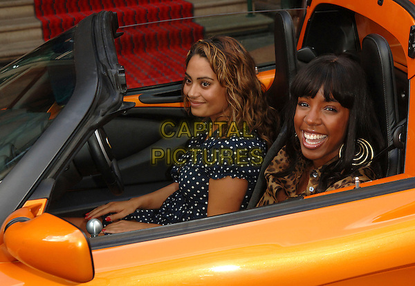 "KELLY ROWLAND.at the Lotus ""Project Eagle"" celebrity unveiling at London Transport Museum at the Covent Garden Piazza,.London, England, UK, July 16th 2008..portrait headshot gold hoop earrings orange fringe sitting in car.CAP/WIZ.©Wizard/Capital Pictures"