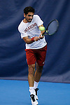 24 MAY 2016:  Oklahoma's Axel Alvarez hits the ball during singles play. The Division I Men's Tennis Championship is held at the Michael D. Case Tennis Center on the University of Tulsa campus in Tulsa, OK.  Virginia defeated Oklahoma for the national championship. Shane Bevel/NCAA Photos